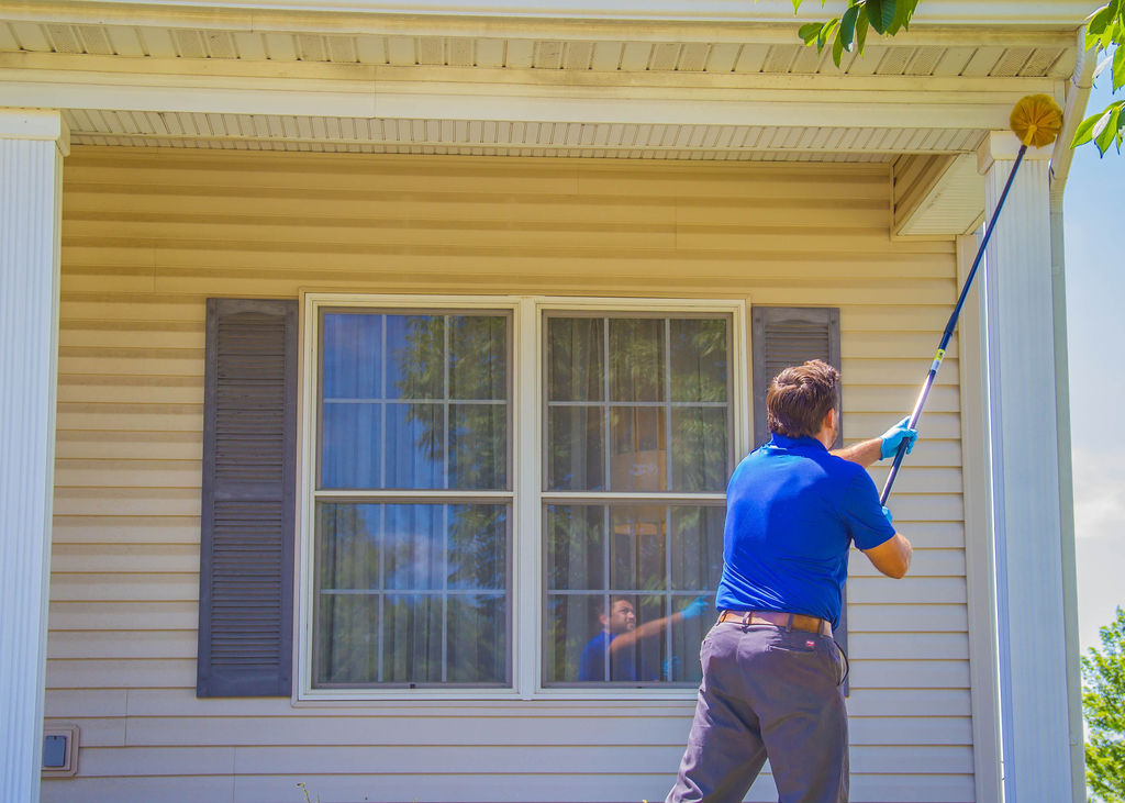 Treating a home during a quarterly pest control treatment